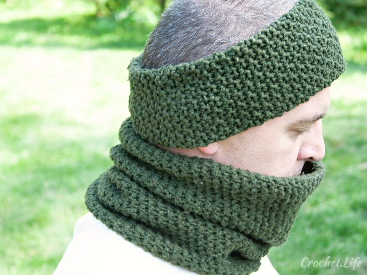 Man wearing dark green cowl and matching headband