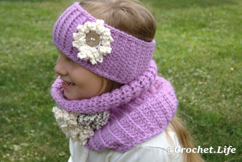 Cute child sized crochet headband worn by a blonde girl.