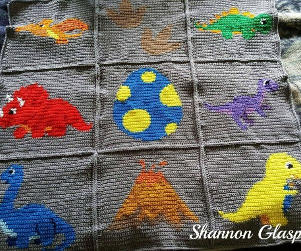 Grey dinosaur crochet blanket