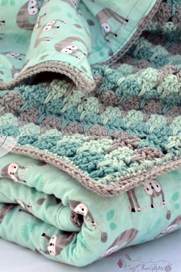 Teal and grey crocheted sloth blanket
