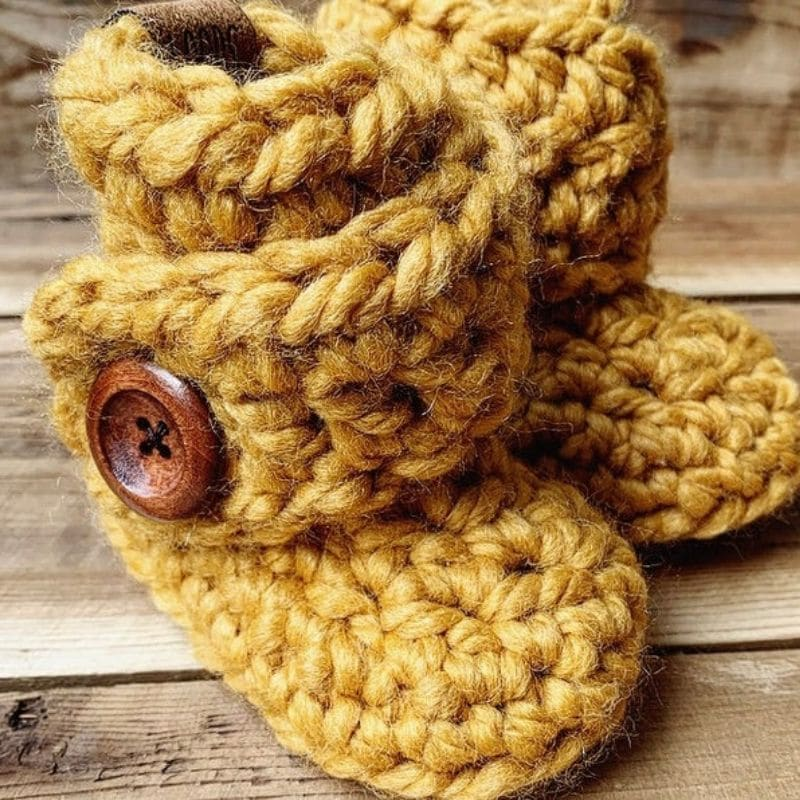 Brown chunky yarn baby booties with button
