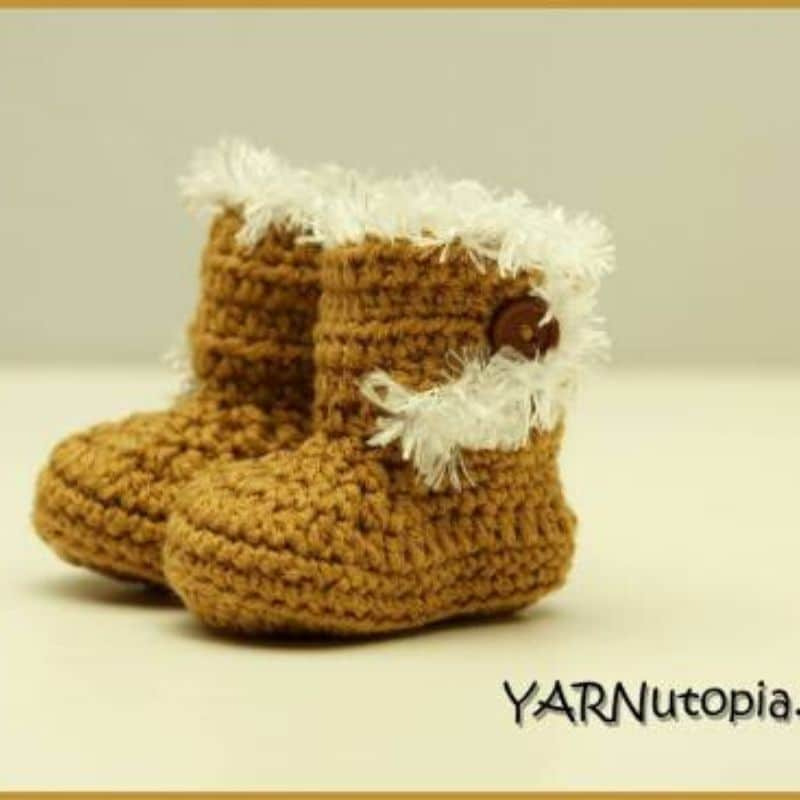 Brown crochet baby booties with fur accent