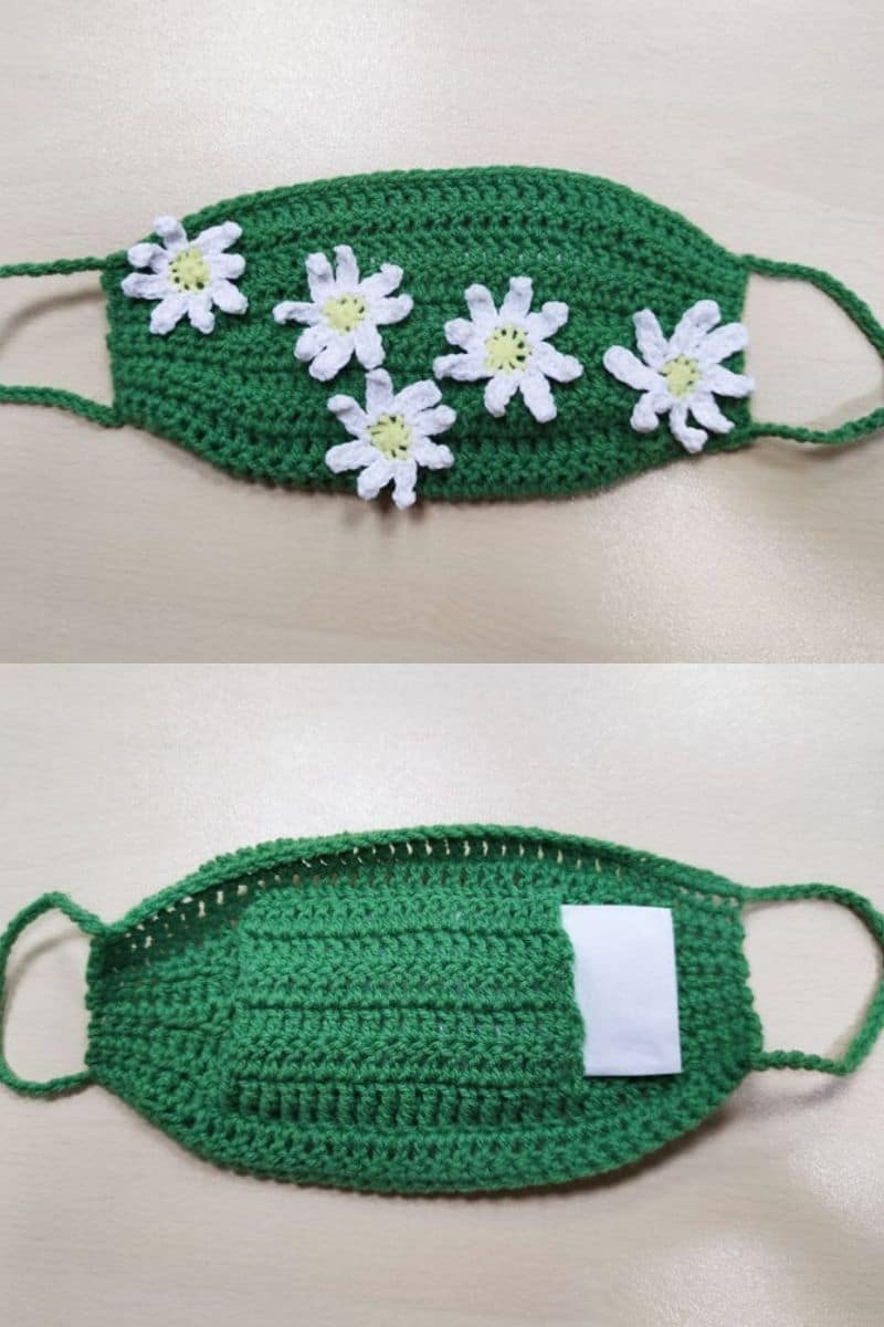 Green crochet mask with white flower