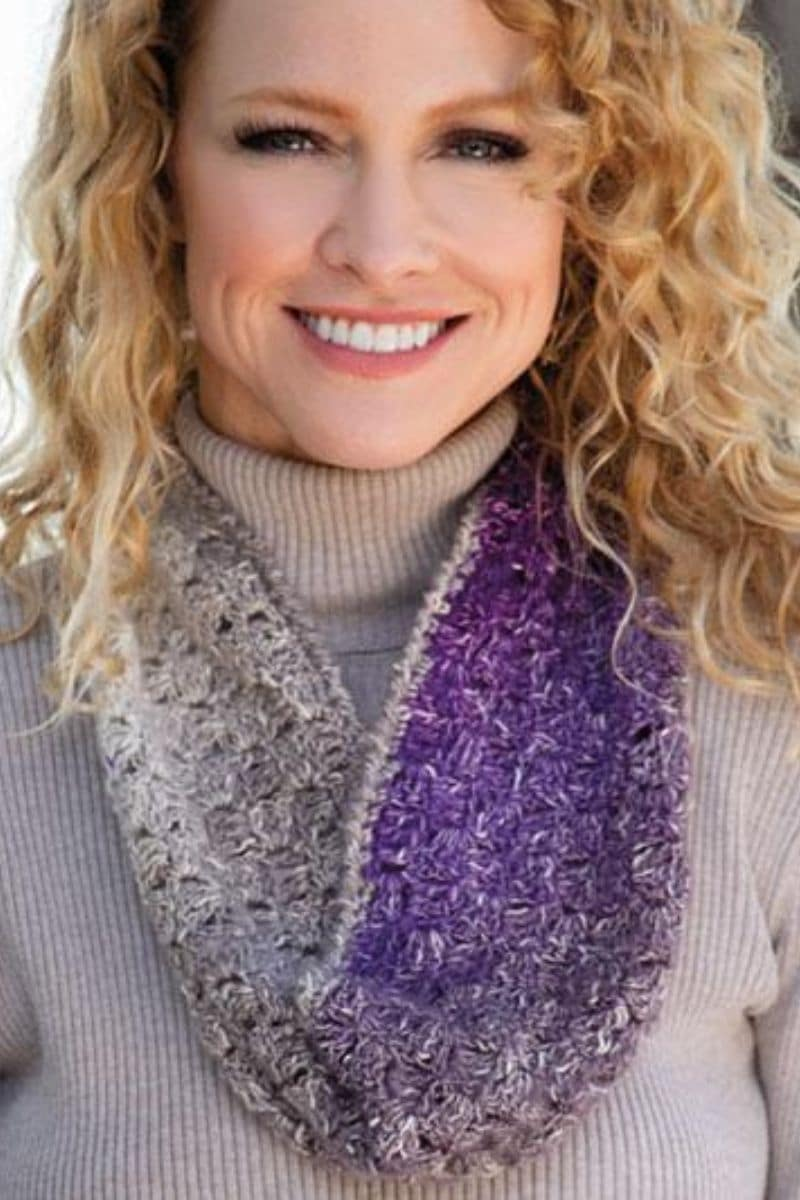 Blonde wearing purple ombre scarf