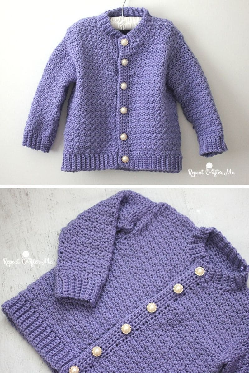 Purple cardigan with pearl buttons on hanger