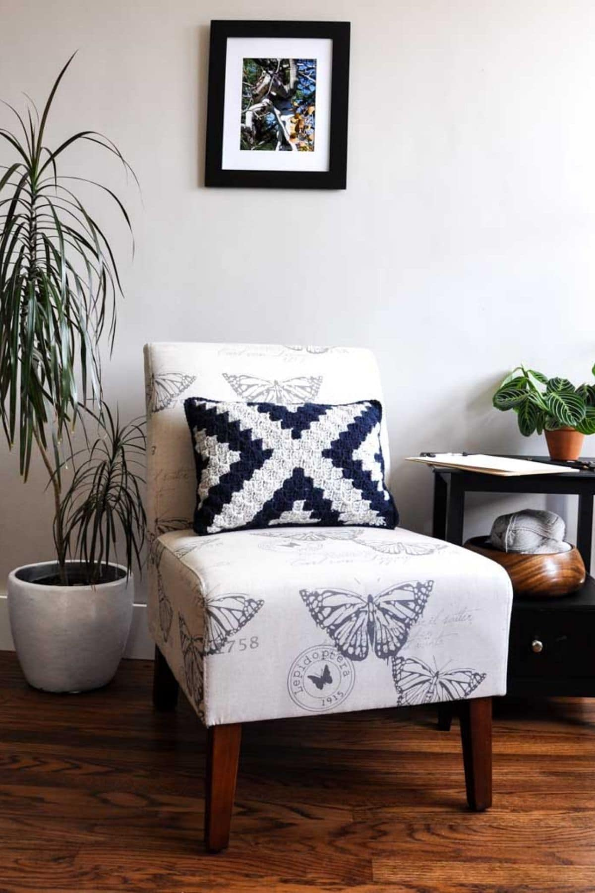 Black and white pillow with an x on the middle